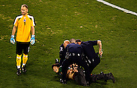 A futbol fan races around the Bank of America stadium field when Iceland vs. Mexico during an international exhibition game held a Bank of America Stadium in Charlotte, North Carolina. The man was tackled by security and led away. The teams tied 0-0. .