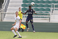 CARY, NC - AUGUST 01: Akeem Ward #30 heads the ball away from Jake Rufe #13 during a game between Birmingham Legion FC and North Carolina FC at Sahlen's Stadium at WakeMed Soccer Park on August 01, 2020 in Cary, North Carolina.