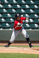 Joseph Odom (13) of the Carolina Mudcats pops up a bunt attempt against the Winston-Salem Dash at BB&T Ballpark on April 22, 2015 in Winston-Salem, North Carolina.  The Dash defeated the Mudcats 4-2..  (Brian Westerholt/Four Seam Images)