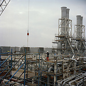 Baku, Azerbaijan .December 14, 2006..Workers build the British Petroleum off-shore platform (on shore) at the ATA construction site near Baku. The ACG Project Phase 3 for deep-water GunashliIt should be complete in 2007 and shipped into place off-shore at the end of 2007...The rig will be part of an elaborate oil drilling platform - one of 5 now on-line in the Caspian sea for BP and the Azeri government. This oil will flow down the Baku-Tbilisi-Ceyhan (BTC) oil export pipeline, connecting Caspian oil to a Turkish port at Ceyhan and western Europe.