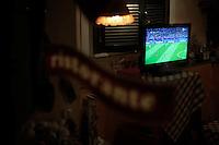 Partita finale Italia-Spagna del campionato europeo di calcio 2012..Final match Italy-Spain of European Football Championship 2012..Schermi televisivi in strada , nei ristoranti e nei locali sintonizzati sulla partita..TV screens in the street, in restaurants and local tuned on the game.