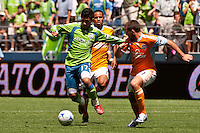 Fredy Montero (l) of the Seattle Sounders drives past Ricardo Clark (c) and Mike Chabala (r) of the Houston Dynamos in the match at the XBox Pitch at Quest Field on July 11, 2009. The Sounders defeated the Dynamo 2-1.