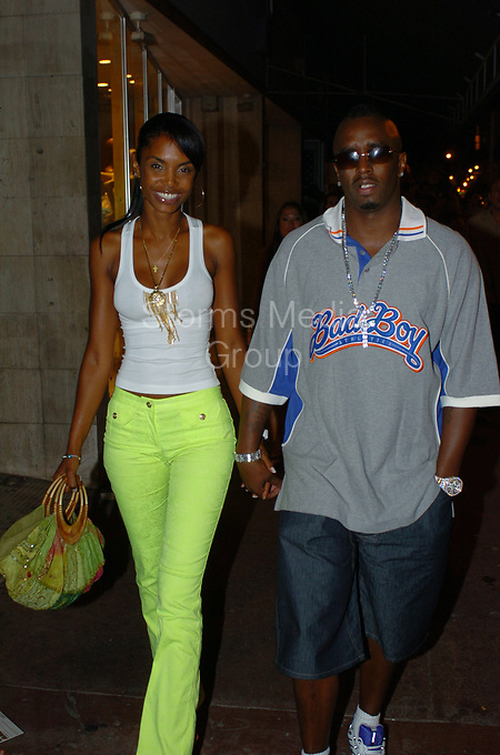 "08/20/2004 - EXCLUSIVE COVERAGE<br /> <br /> Sean ""Puffy Combs sports a new mohawk haircut while escorting girlfriend Kim Porter into club Mansion in Miami Beach <br /> <br /> Miami Beach, Florida"
