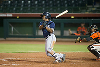 AZL Padres 2 second baseman Eguy Rosario (1) follows through on his swing against the AZL Giants on July 13, 2017 at Scottsdale Stadium in Scottsdale, Arizona. AZL Giants defeated the AZL Padres 2 11-3. (Zachary Lucy/Four Seam Images)