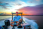 """Justin Wallheiser on his way back to Shell Point from fishing the """"skinny"""" water."""