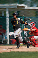 Pittsburgh Pirates Samuel Inoa (17) at bat in front of catcher Mitchell Edwards during a minor league Spring Training game against the Philadelphia Phillies on March 13, 2019 at Pirate City in Bradenton, Florida.  (Mike Janes/Four Seam Images)