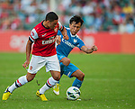 Alex Oxlade-Chamberlain of Arsenal FC and Lo Kwan Yee of Kitchee in action during the pre-season Asian Tour friendly match at the Hong Kong Stadium on July 29, 2012. Photo by Victor Fraile / The Power of Sport Images