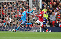 Pictured L-R: Swansea goalkeeper Lukasz Fabianski chased by Wayne Rooney of Manchester United. Saturday 16 August 2014<br /> Re: Premier League Manchester United v Swansea City FC at the Old Trafford, Manchester, UK.