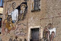Orgosolo, Nuoro, 2 Gennaio 2018<br /> Il piccolo centro della Barbagia famoso per i dipinti che adornano le vecchie case del centro storico,e gli edifici di nuova costruzione, piazze e muri del paese. I Murales di Orgosolo narrano di storia, di politica, di vita quotidiana, e di tradizione e di Sardegna.