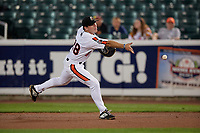 Aberdeen IronBirds first baseman Andrew Daschbach (28) flips the ball to the pitcher covering the bag during a NY-Penn League game against the Vermont Lake Monsters on August 19, 2019 at Leidos Field at Ripken Stadium in Aberdeen, Maryland.  Aberdeen defeated Vermont 6-2.  (Mike Janes/Four Seam Images)