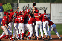 Auburn Doubledays players including Victor Robles (27), Telmito Agustin (3), Kelvin Gutierrez (5), Jake Jefferies (23), Melvin Rodriguez (16) mob Diomedes Eusebio (31) after a walk off base hit during a game against the Batavia Muckdogs on September 7, 2015 at Falcon Park in Auburn, New York.  Auburn defeated Batavia 11-10 in ten innings.  (Mike Janes/Four Seam Images)