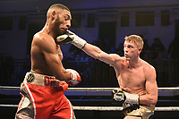 Liam Wells (black shorts) defeats Ohio-Kain Iremiren during a Boxing Show at York Hall on 9th November 2019