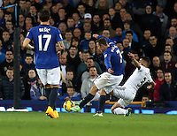 Liverpool, UK. Saturday 01 November 2014<br /> Pictured: Neil Taylor of Swansea (R) tackling Aiden McGeady of Everton (C)<br /> Re: Premier League Everton v Swansea City FC at Goodison Park, Liverpool, Merseyside, UK.