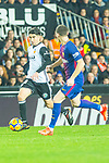 Alvaro Medran of Valencia CF competes for the ball with Thomas Vermaelen of FC Barcelona  during the La Liga 2017-18 match between Valencia CF and FC Barcelona at Estadio de Mestalla on November 26 2017 in Valencia, Spain. Photo by Maria Jose Segovia Carmona / Power Sport Images