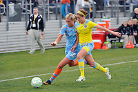 Sinead Farrelly (14) of the Philadelphia Independence challenges Allie Long (10) of Sky Blue FC for the ball. The Philadelphia Independence and Sky Blue FC played to a 2-2 tie during a Women's Professional Soccer (WPS) match at Yurcak Field in Piscataway, NJ, on April 10, 2011.