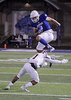 Rogers Mountaineers Senior Aron Rendon (4) leaps over Springdale Bulldogs Junior Davon Sparks (1) Friday, October 16, 2020, at Whitey Smith Stadium, Rogers, Arkansas (Special to NWA Democrat-Gazette/Brent Soule)