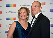 Trombonist Peter Ellefson, right, and guest arrive for the formal Artist's Dinner honoring the recipients of the 40th Annual Kennedy Center Honors hosted by United States Secretary of State Rex Tillerson at the US Department of State in Washington, D.C. on Saturday, December 2, 2017. The 2017 honorees are: American dancer and choreographer Carmen de Lavallade; Cuban American singer-songwriter and actress Gloria Estefan; American hip hop artist and entertainment icon LL COOL J; American television writer and producer Norman Lear; and American musician and record producer Lionel Richie.  <br /> Credit: Ron Sachs / Pool via CNP