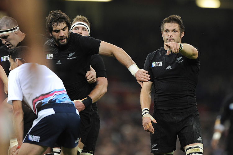 Richie McCaw of New Zealand is held back by Samuel Whitelock of New Zealand during Match 23 of the Rugby World Cup 2015 between New Zealand and Georgia - 02/10/2015 - Millennium Stadium, Cardiff<br /> Mandatory Credit: Rob Munro/Stewart Communications