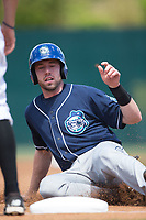 Vince Fernandez (8) of the Asheville Tourists slides into third base during the game against the Kannapolis Intimidators at Kannapolis Intimidators Stadium on May 7, 2017 in Kannapolis, North Carolina.  The Tourists defeated the Intimidators 4-1.  (Brian Westerholt/Four Seam Images)