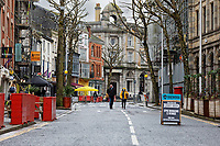 Pictured: Wind Street, the main bar and restaurant district remains deserted in the city centre of Swansea, Wales, UK. Monday 30 November 2020<br /> Re: Pubs and restaurants will have to stop serving alcohol shut at 6pm from this Friday due to the Covid-19 Coronavirus pandemic, Wales, UK.