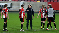 Brentford Manager, Thomas Frank, who recently had a spell self isolating after testing positive for Covid-19 makes sure he doesn't embrace his players at the end of the match during Brentford vs Luton Town, Sky Bet EFL Championship Football at the Brentford Community Stadium on 20th January 2021