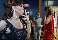 Miss Navaeh Symone, left, and Miss Gwyyn Kelly, right, take long drags off their cigarettes waiting backstage for the pageant to begin at Club 216 in Charlottesville, VA.
