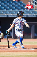 Scottsdale Scorpions second baseman Andres Gimenez (13), of the New York Mets organization, follows through on his swing during an Arizona Fall League game against the Peoria Javelinas at Peoria Sports Complex on November 15, 2018 in Mesa, Arizona. Peoria defeated Scottsdale 2-1. (Zachary Lucy/Four Seam Images)
