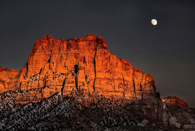 A bright rising moon makes an appearance at Zion National Park, Utah