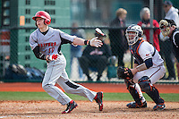 Sebastian DiMauro (20) of the Hartford Hawks follows through on his swing against the Virginia Cavaliers at The Ripken Experience on February 27, 2015 in Myrtle Beach, South Carolina.  The Cavaliers defeated the Hawks 5-1.  (Brian Westerholt/Four Seam Images)