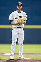 Michigan Wolverines pitcher Steven Hajjar (27) looks to his catcher for the sign against the Ohio State Buckeyes on April 9, 2021 in NCAA baseball action at Ray Fisher Stadium in Ann Arbor, Michigan. Ohio State beat the Wolverines 7-4. (Andrew Woolley/Four Seam Images)