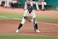 Matthew Fraizer (14) of the Greensboro Grasshoppers takes his lead off of first base against the Wilmington Blue Rocks at First National Bank Field on May 25, 2021 in Greensboro, North Carolina. (Brian Westerholt/Four Seam Images)