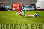 Brosnas Killian Fitzmaurice clears his defence under pressure from Aaron McCarthy of Listry in the Junior Premier Football Championship quarter final.