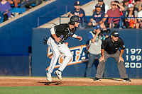 University of Washington Huskies Jonathan Schiffer (3) takes his lead off of first base against the Cal State Fullerton Titans at Goodwin Field on June 10, 2018 in Fullerton, California. The Huskies defeated the Titans 6-5. (Donn Parris/Four Seam Images)