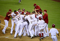 Jun. 8, 2012; Phoenix, AZ, USA; Arizona Diamondbacks third baseman Ryan Roberts (not pictured) is congratulated by teammates after hitting a three run walk off home run in the ninth inning against the Oakland Athletics at Chase Field.  Mandatory Credit: Mark J. Rebilas-