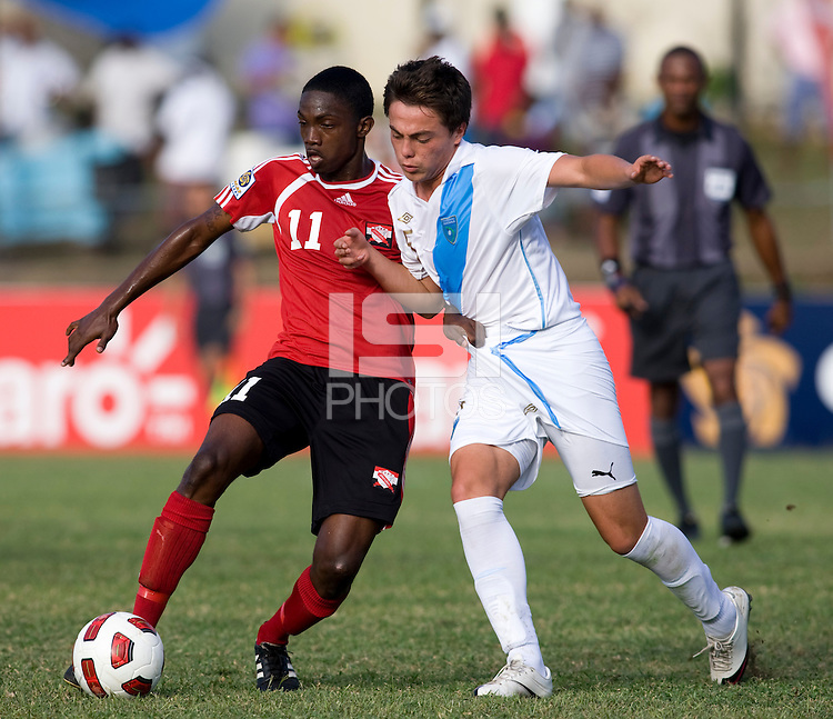 Julio Ortiz (5) of Guatemala fights for the ball with Garvin Samaroo (11) of Trinidad & Tobago  during the group stage of the CONCACAF Men's Under 17 Championship at Jarrett Park in Montego Bay, Jamaica. Trinidad & Tobago defeated Guatemala, 1-0.