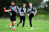 Kyle Naughton (left) and Barrie McKay (right) of Swansea City in action during the Swansea City Training Session at The Fairwood Training Ground, Wales, UK. Tuesday 11th September 2018