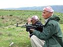 Iraq 2015 <br /> A picnic of Nowruz in wartime near Duhok, peshmergas on alert watching for a possible danger <br /> Irak 2015 <br /> Un pique-nique de Nowruz en temps de guerre a cote de Dohok: peshmergas en alerte surveillant un danger possible
