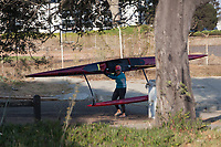 Once out of the water, it's a one person job to carry a small outrigger canoe - Encinal Boat Ramp on San Francisco Bay