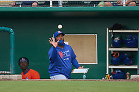 St. Lucie Mets pitching coach catches the first strikeout ball from starting pitcher J.T. Ginn (47) professional debut during a game against the Fort Myers Mighty Mussels on June 3, 2021 at Hammond Stadium in Fort Myers, Florida.  (Mike Janes/Four Seam Images)