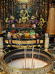 Bao-jhong Yi-min Temple, Kaohsiung -- Incense brazier and god statue in the main hall of a Taoist temple.