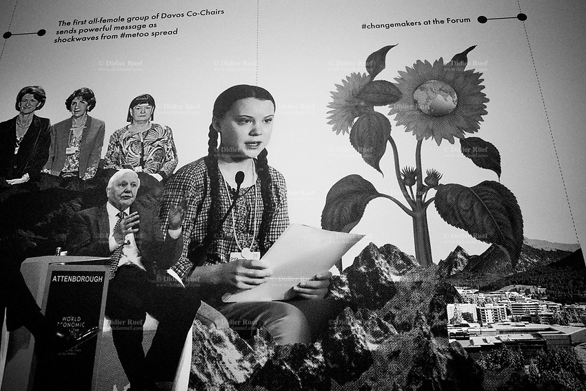 """Switzerland. Canton Graubunden. Davos. A poster celebrating the 50th edition of the World Economic Forum (WEF) with Greta Thunberg, Richard Attenborough, the first all-female groups, sunflowers, the Swiss Alps and the village of Davos. The World Economic Forum (WEF) Annual Meeting in Davos is the foremost creative force for engaging the world's top leaders in collaborative activities to shape the global, regional and industry agendas at the beginning of each year. It brings together 3,000 participants from around the world, and aim to give concrete meaning to """"stakeholder capitalism"""", assist governments and international institutions in tracking progress towards the Paris Agreement and the Sustainable Development Goals, and facilitate discussions on technology and trade governance. Greta Thunberg (born 3 January 2003) is a Swedish environmental activist on climate change whose campaigning has gained international recognition. Thunberg is known for her straightforward speaking manner, both in public and to political leaders and assemblies, in which she urges immediate action to address what she describes as the climate crisis. Richard Samuel Attenborough, Baron Attenborough, CBE, FRSA (29 August 1923 – 24 August 2014) was an English actor, filmmaker, entrepreneur, and politician. 18.01.2020 © 2020 Didier Ruef"""
