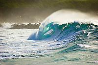 A Beautiful large wave barrels in the powerful shorebreak at Waimea Bay, on the North Shore of Oahu.