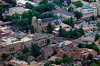 aerial photograph of central Santa Fe, New Mexico, Cathedral Basilica of St. Francis of Assisi in the center,  Loretto Chapel and Inn and Spa at Loretto in foreground
