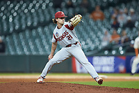Arkansas Razorbacks relief pitcher Jacob Burton (21) in action against the Texas Longhorns in game six of the 2020 Shriners Hospitals for Children College Classic at Minute Maid Park on February 28, 2020 in Houston, Texas. The Longhorns defeated the Razorbacks 8-7. (Brian Westerholt/Four Seam Images)