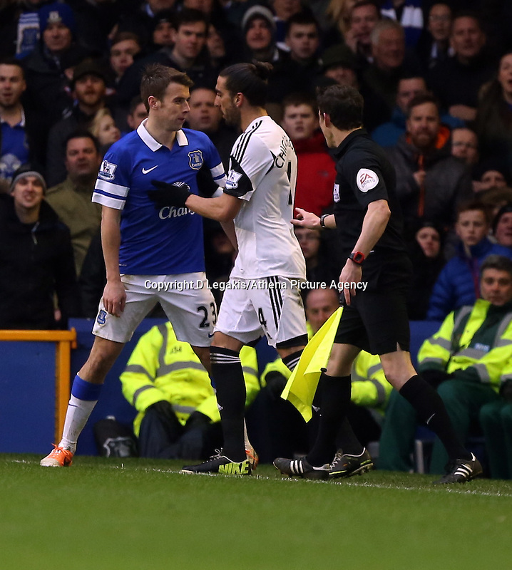 Pictured L-R: Seames Coleman of Everton squares up against Chico Flores of Swansea. Saturday 22 March 2014<br /> Re: Barclay's Premier League, Everton v Swansea City FC at Goodison Park, Liverpool, UK.