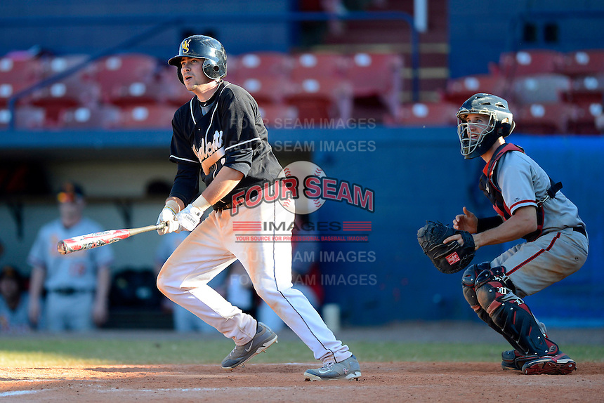 Wayne State Wildcats third baseman Michael Herman #1 bats in front of catcher Paul Richmond #28 during a game against the University of Missouri - St Louis Tritons at Chain of Lakes Stadium on March 8, 2013 in Winter Haven, Florida.  Wayne State defeated UMSL 3-2 in fourteen innings.  (Mike Janes/Four Seam Images)
