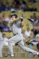 San Diego Padres catcher Nick Hundley #4 bats against the Los Angeles Dodgers at Dodger Stadium on August 30, 2011 in Los Angeles,California. Los Angeles defeated San Diego 8-5.(Larry Goren/Four Seam Images)