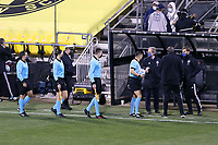 COLUMBUS, OH - DECEMBER 12: Head coach Brian Schmetzer of the Seattle Sounders FC greets Referee Jair Marrufo, as well as Assistant Referees Corey Parker, Kathryn Nesbitt, and Fourth Official Alex Chilowicz before a game between Seattle Sounders FC and Columbus Crew at MAPFRE Stadium on December 12, 2020 in Columbus, Ohio.