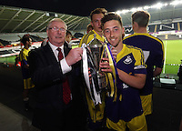 Thursday, 16 April 2014<br /> Pictured L-R: FAW representative presents Swansea team captain Josh Sheehan with the Youth Cup. <br /> Re: FAW Youth Cup Final, Swansea City FC v The New Saints FC at the Liberty Stadium, south Wales,
