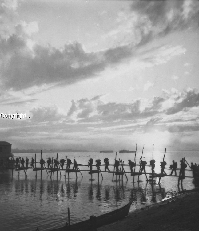 Silhouette of troops at Pandu Ghat.  124th Cavalry Regt., 5332nd Brigade (Prov) on move from Ramgarh Training Center to Myitkyina, Burma.  October 25, 1944.  T5c. Kirsten.  (Army)<br /> NARA FILE #:  111-SC-197483<br /> WAR & CONFLICT BOOK #:  1159